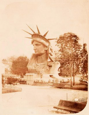 Head+of+the+Statue+of+Liberty+on+display+in+a+park+in+Paris.+Fernique,+Albert+--+Photographer.+1883